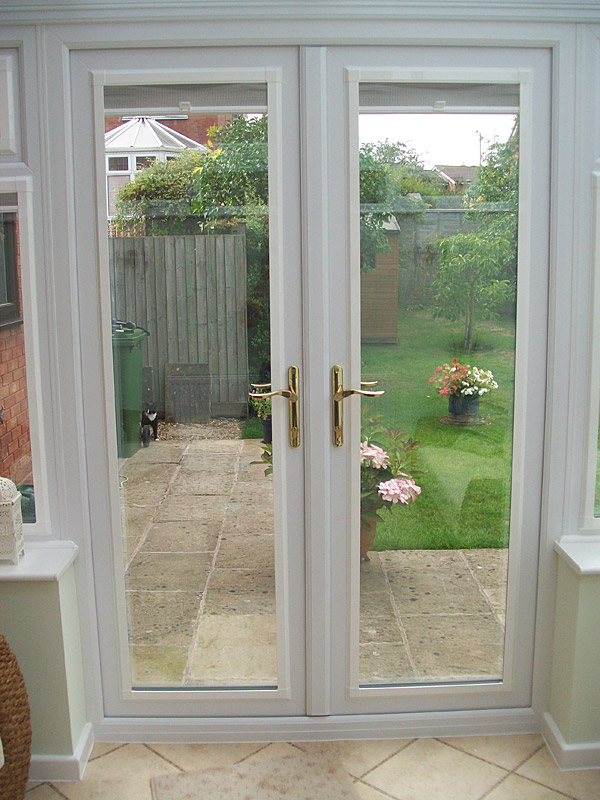 Upvc french doors replacement french doors from altus for Replacement upvc windows