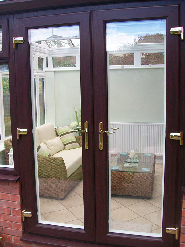Upvc french doors replacement french doors from altus for Replacement french doors