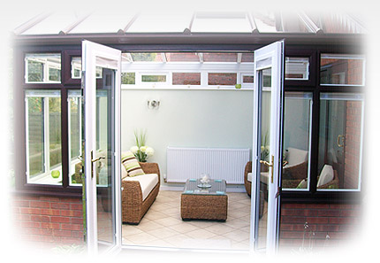 A photo of a man reclining next to a composite patio door