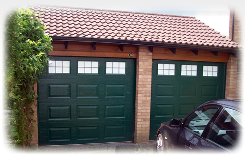 A photo of a pair of adjoining garage doors
